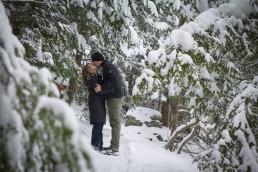 winter snow shoe engagement portrait in snowy woods of Vermont