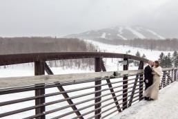 portrait of couple at winter wedding in Killington Vermont