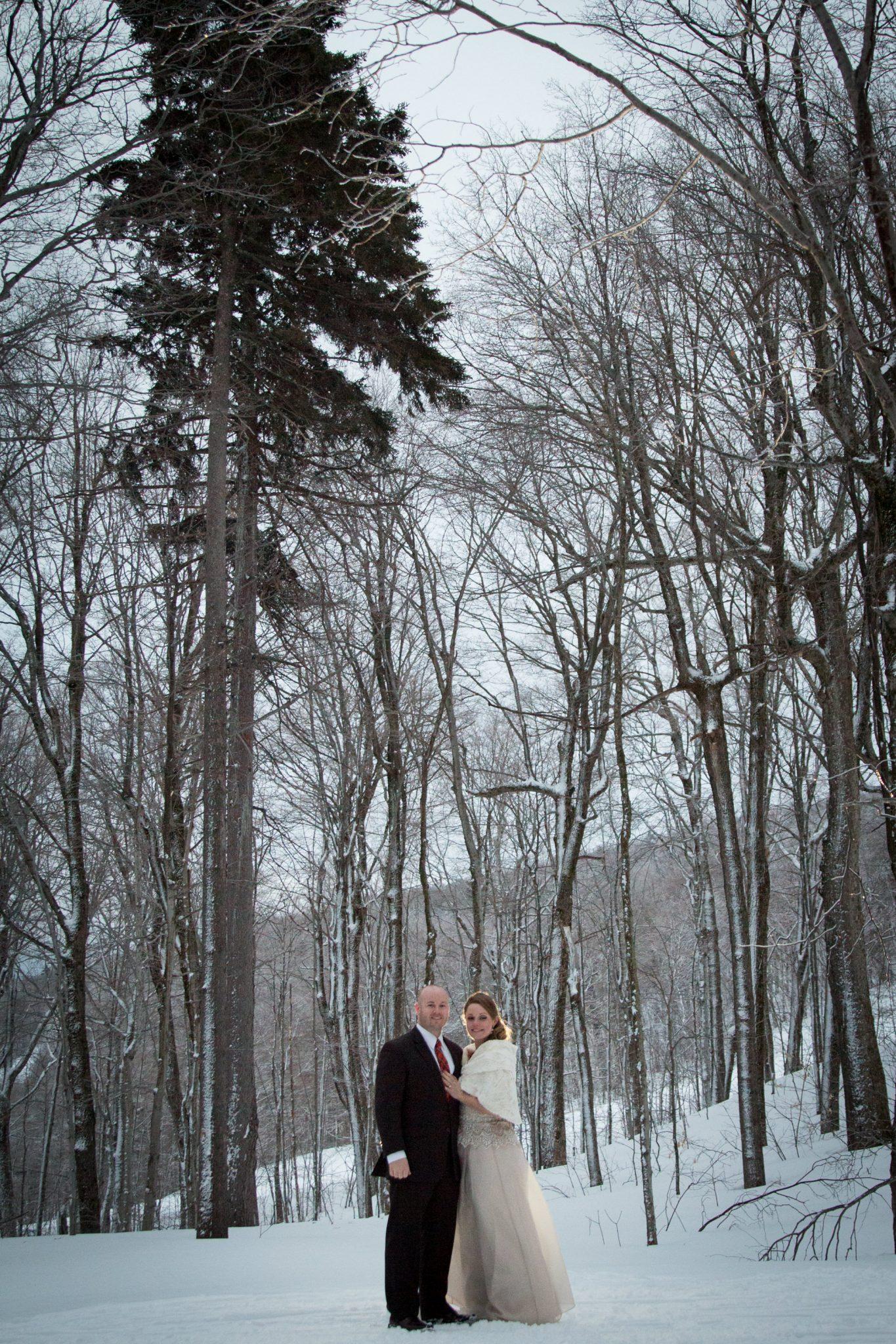 winter wedding couples portrait atop Killington, Vermont