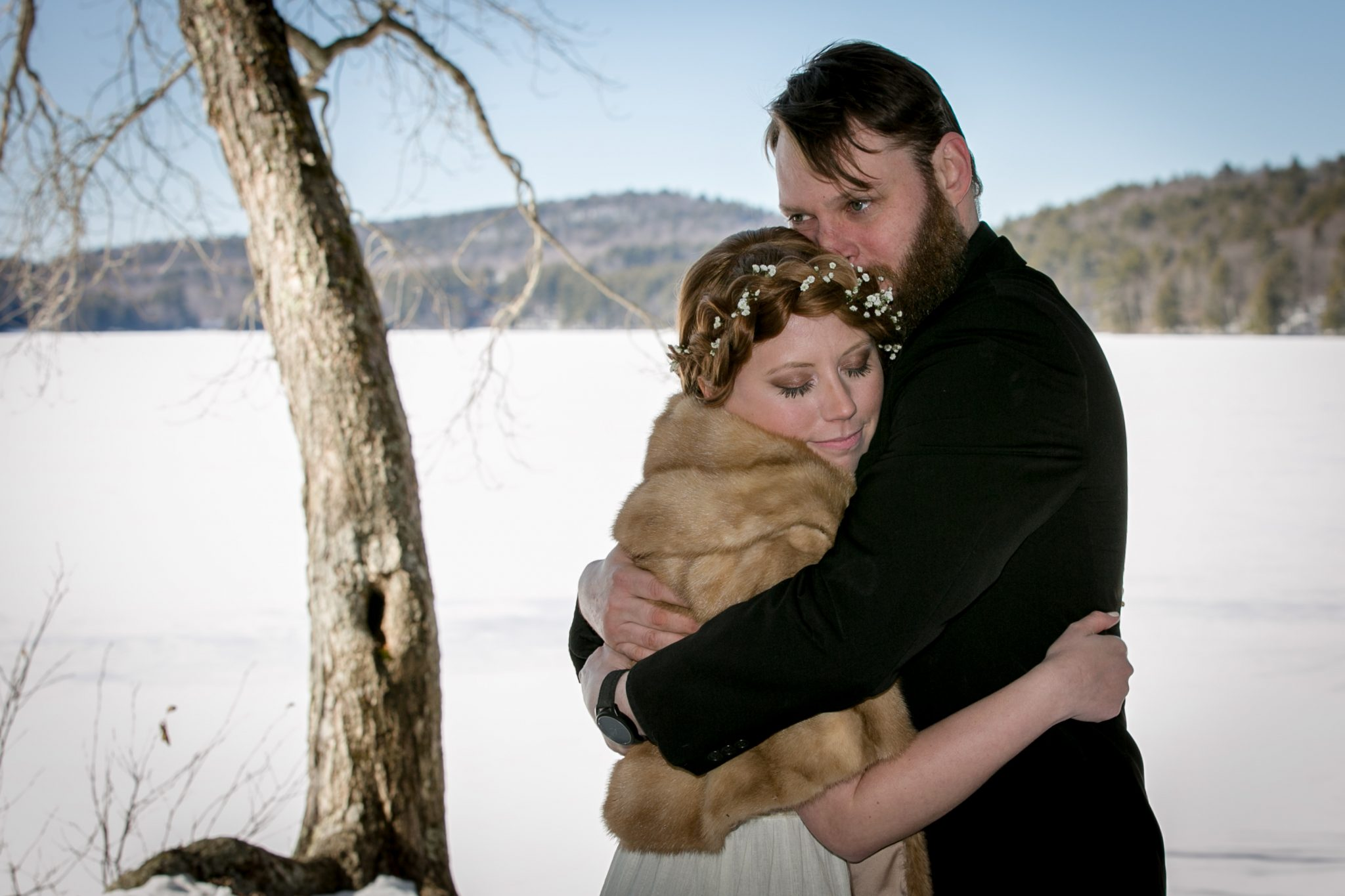 wedding candid portrait in the winter woods of Maine by Vermont wedding photographer