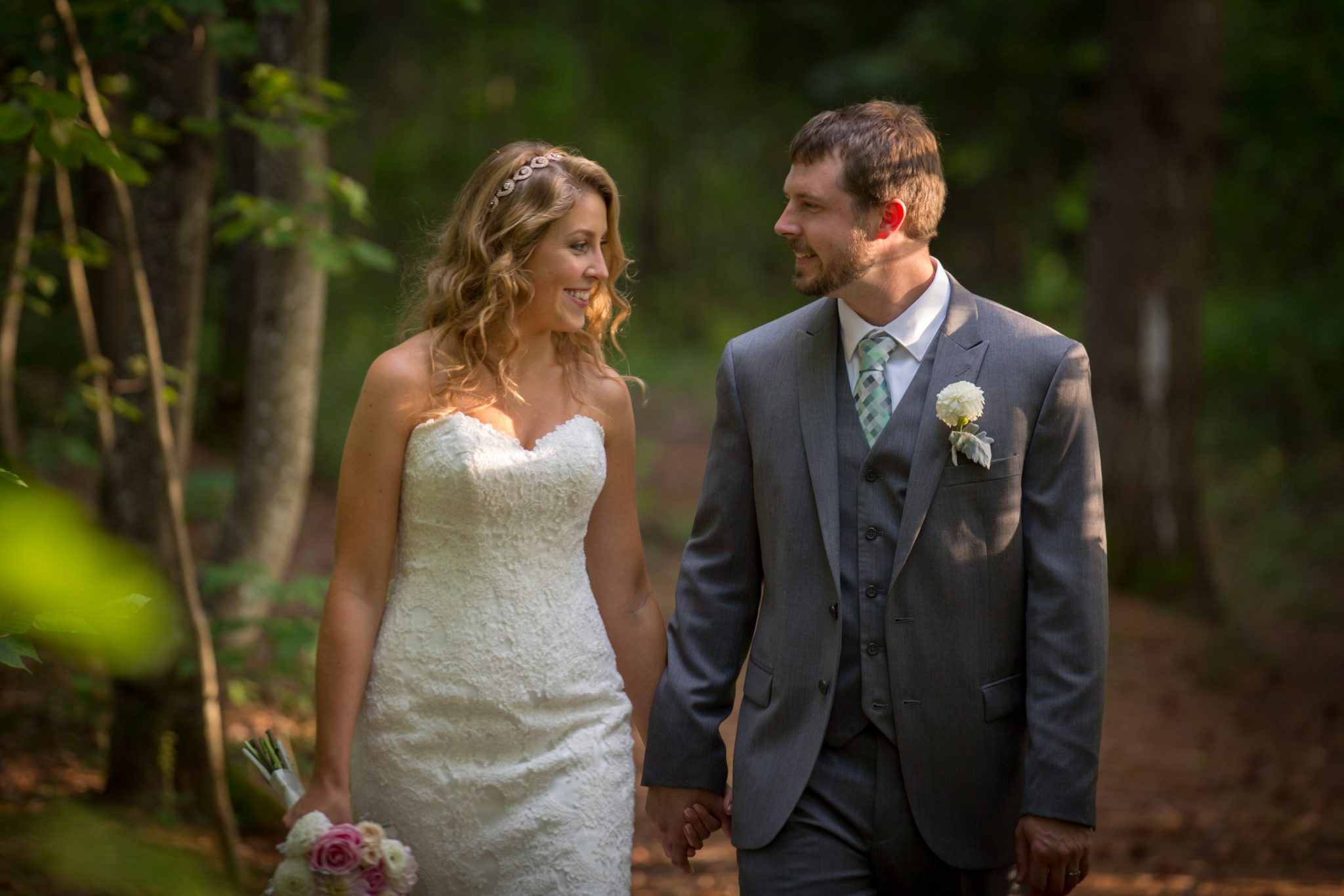 wedding couple walking in the woods. Portrait at the Alerin Barn in Vermont