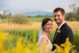 summer wedding portrait in field of yellow flowers at catamount outdoor center in vermont