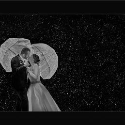 black and white wedding portrait in rain